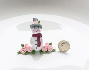 Christmas snowman ornament in pink handmade from polymer clay
