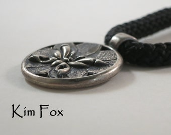 Round Butterfly highly dimensional Pendant with cut outs in Sterling silver designed by Kim Fox