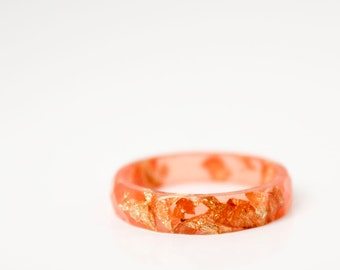size 8 thin multifaceted eco resin ring | sunset orange with gold leaf flakes