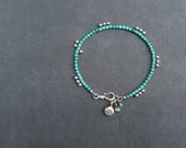 RESERVED - Small Turquoise Bracelet with Sterling Silver Charms