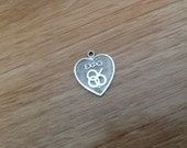 VINTAGE - Expo 86 silver heart shaped charm