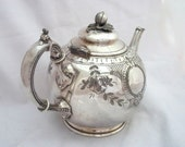 SILVERPLATE ENGLISH TEAPOT Silver Plate Floral Finial Thumb Rest Graceful Fluted Spout Sheffield England Victorian Elegant Unusual 1800's