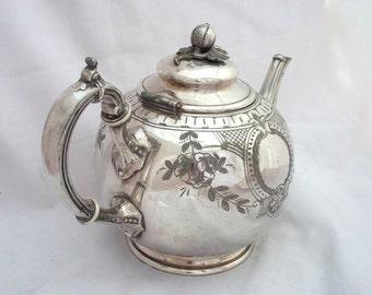 SILVERPLATE ENGLISH TEAPOT Silver Plate Floral Finial Thumb Rest Graceful Fluted Spout Sheffield England Victorian 1800's