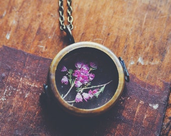 pink heather botanical locket necklace.