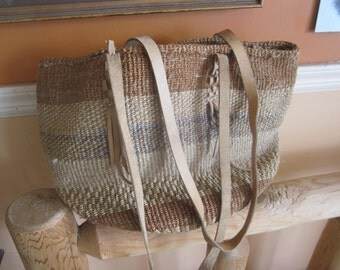 large vintage sisal tote  bag, boho bag, hippie, neutral colors.leather trim and strap
