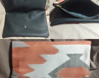 Aztec and black vinyl snap foldover clutch...no internal pockets