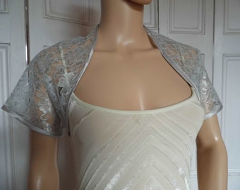 Silver lace cap sleeved bolero/shrug/jacket  with satin edging