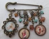 Kilt pin brooch - seahorses starfish shell seaside  retro, bronze