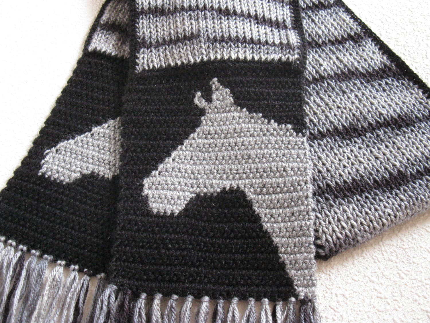 Knitted Horse Scarf. Gray and black striped scarf with horse