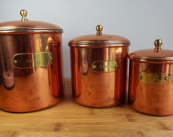 Three vintage copper storage jars from France, sucre, café and thé