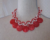 Vintage Red Swirl Plastic Disc Necklace on a Red and White Plastic Chain Necklace