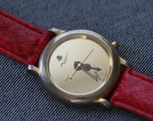 Vintage gold tone quartz watch with violin and bow musician mens womens red strap
