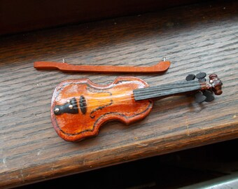 Miniature violin and bow