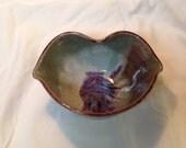 Small lips / kiss bowl, wheel-thrown stoneware.  Handmade.  Red, white, purple.