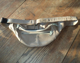 Vintage Tan Leather Fanny Pack with three (3) zippered compartments with adjustable leather waist strap in Good Vintage Condition