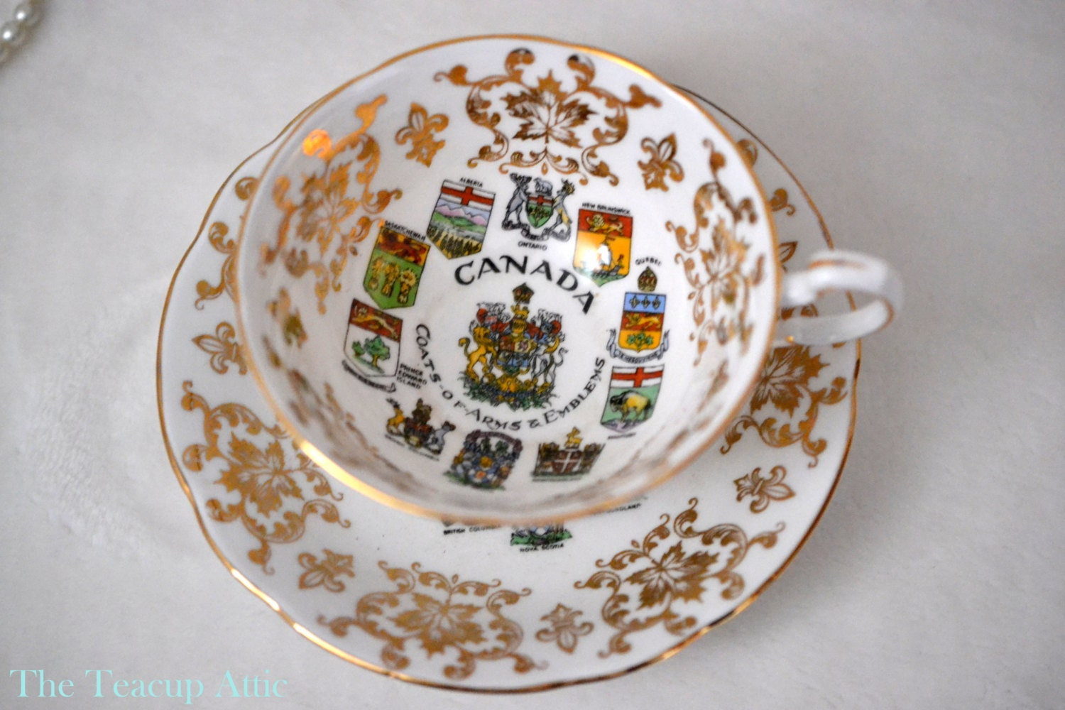 Paragon Canadian Provincial Emblems Teacup and Saucer Set, Coat of Arms and Emblems English Bone China, ca. 1953