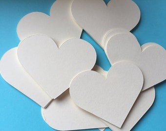 25 die cut paper hearts.....you choose size and color.  Valentine hearts.  Wedding hearts.  Wedding heart tags.