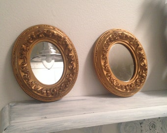 Little gold framed wall mirrors