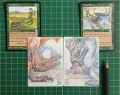 A matching pair of Magic the Gathering Artist's Proofs with colour pencil sketch of the Welsh Dragon and the Anglo-Saxon wyvern on the back