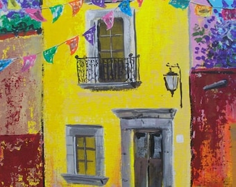 """Original painting of yellow house with Spring celebration flags in San Miguel de Allende Mexican town acrylic on board 11 """"x 14"""""""