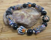 RESERVED for Pat -- 2 African Zebra trade bead bracelets with black wood beads, hand painted elbow beads, black star beads, silver spacers