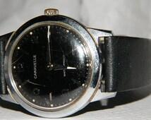 Mens Caravelle Black Dial Luminous Markers Waterproof Mechanical Wind Watch