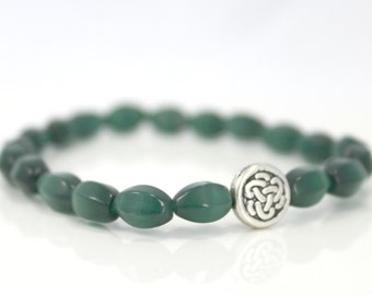 Emerald Glass Stretch Bracelet with Silver Plated Celtic Knot Accent / Gifts under 20