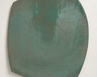 sea foam green gloss glaze on dark clay plate
