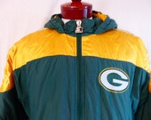 vintage 90's Green Bay Packers color block green gold yellow hooded insulated anorak nylon jacket embroidered logo starter proline large med