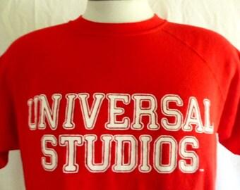 vintage 80s Universal Studios Hollywood short sleeve red fleece graphic sweatshirt raglan crew neck white logo tourist travel souvenir large