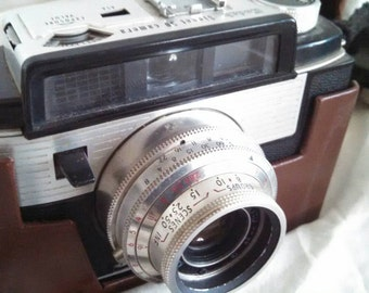 Vintage Kodak signet 50 camera with leather case and flash