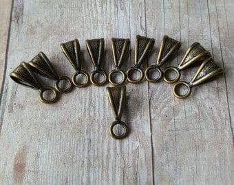 Lot of 10 antique copper bails