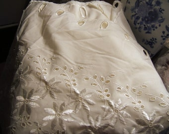 Awesome eyelet lace with openings at top for threading ribbon, etc.