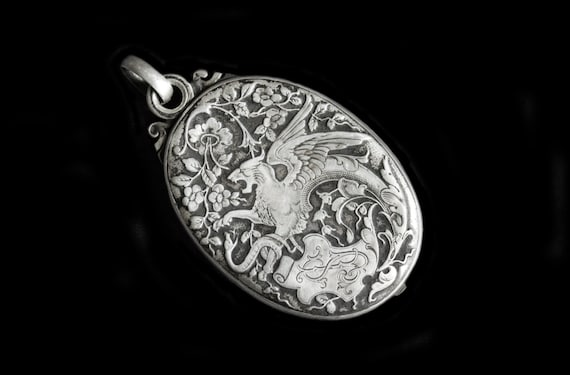 Sterling Silver Slide Locket W/Gryphon
