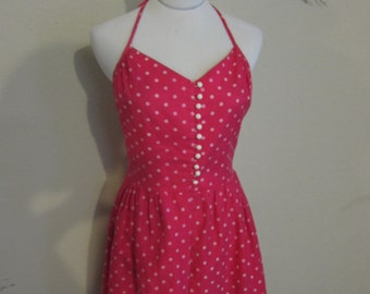 Pink and white polka dot halter dress with buttons and pockets