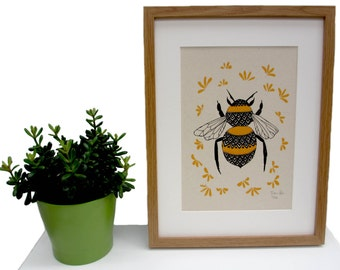 Art print 'Bee and Blossom' a 2 colour screen print featuring a bumble bee surrounded by blossom