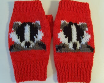 Badger Intarsia Fingerless Mitts on an red background