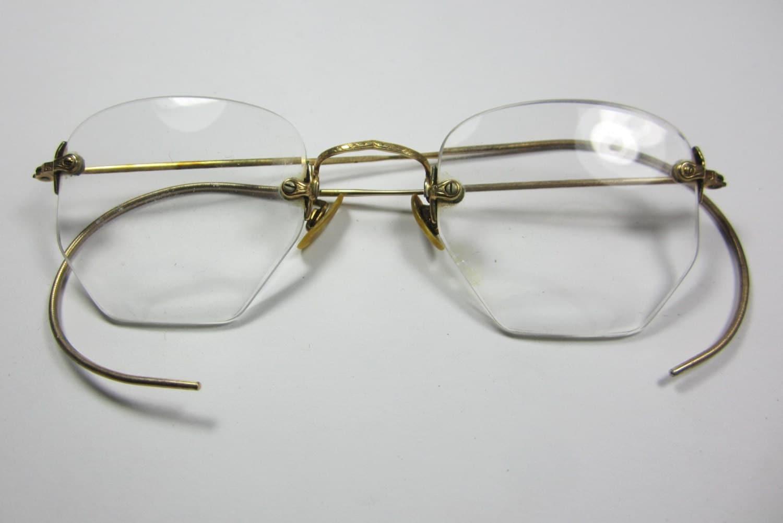 Antique wire rimmed gold filled eyeglasses.