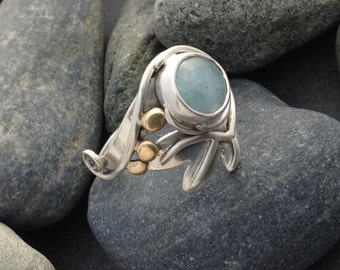 Pale blue aquamarine sterling silver ring, solid but feminine design,  unusual wrap around design, mixed metal brass disks, size 8 and 1/4