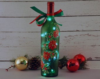 Holly berries and poinsettia, Christmas wine bottle light, hand painted, reclaimed wine bottle