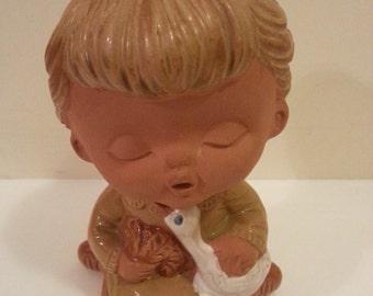 Ceramic Figurine of Little Girl Hlding Duck
