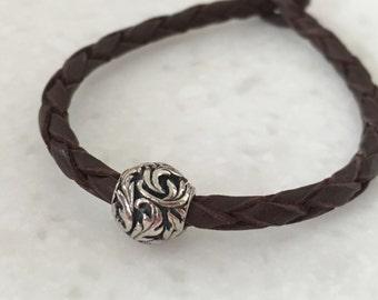 Sterling silver floral focal on braided kangaroo leather bracelet