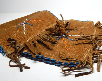 Vintage Iroquois or First Nations beaded leather wrist cuffs.  8x6