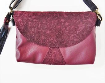 Burgundy leather crossbody bag or shoulder bag, with embossed trim. Dark red leather handbag.