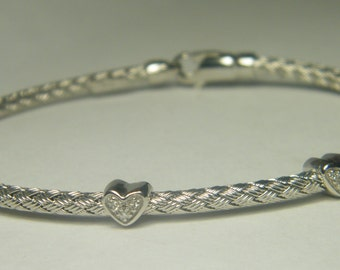 14 karat white gold flexible 3 diamond heart bracelet