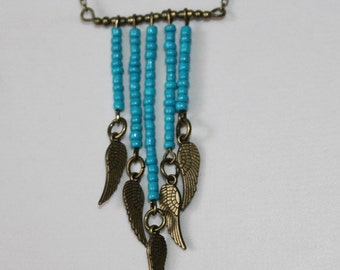 Chain in ethno style with bronze wings and turquoise elements