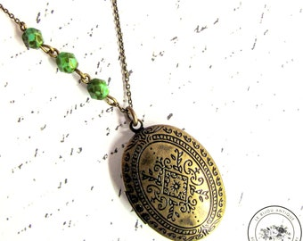 Antique Locket necklace Oval shaped in Antique bronze with green crystals vintage moroccan Patterns Two pictures family keepsake