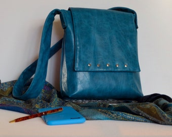 Striking teal vegan leather purse with silver stud detail on flap