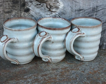 Ceramic Coffee cup, Stoneware tea cup.This listing is for 1 of the three mugs shown in the photograph.