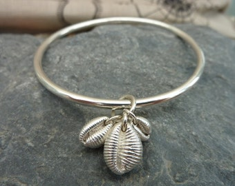Cowrie shell family bangle in sterling silver...